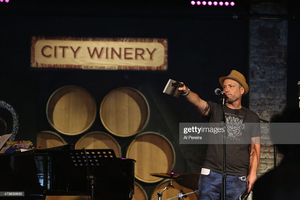 City Winery owner Michael Dorn auctions off signed books by Patti Smith at the Everest Awakening: A Prayer for Nepal and Beyond Benefit show at City Winery on May 17, 2015 in New York City.