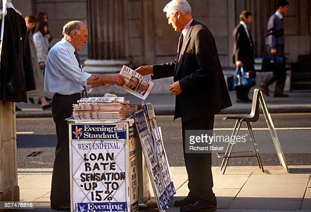 A city worker buys a copy of the Evening Standard with a headline relating to the ERM crisis in 1992 known as Black Wednesday which referred to the...