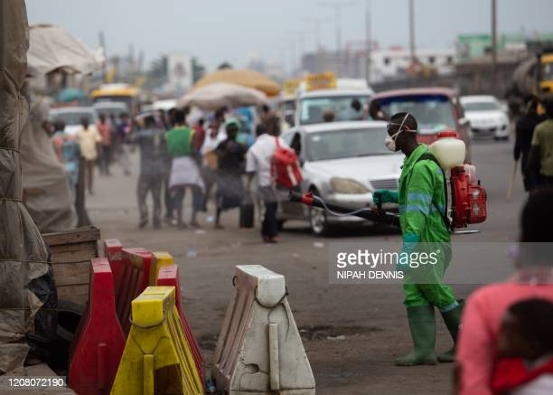 A city worker disinfects a market as a preventive measure against the spreading of COVID19 Coronavirus in Accra on March 23 2020 African countries...