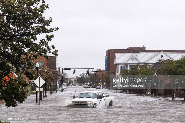 City worker drives through the flooded street during Hurricane Sally in downtown Pensacola, Florida on September 16, 2020. - Hurricane Sally...