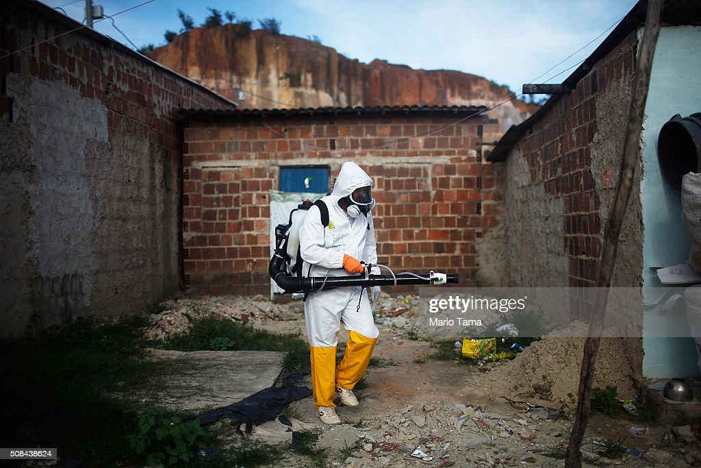 A city worker fumigates in an effort to eradicate the mosquito which transmits the Zika virus on February 4, 2016 in Recife, Pernambuco state, Brazil. Officials say as many as 100,000 people may have already been exposed to the Zika virus in Recife, which is being called the epicenter of the crisis, although most never develop symptoms. Tourists are arriving in the city for its famed Carnival celebrations which begin tomorrow.