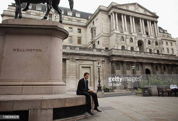 A city worker sits alone in front of the Bank of England on September 22 2011 in London England Share prices on world stock markets have fallen...