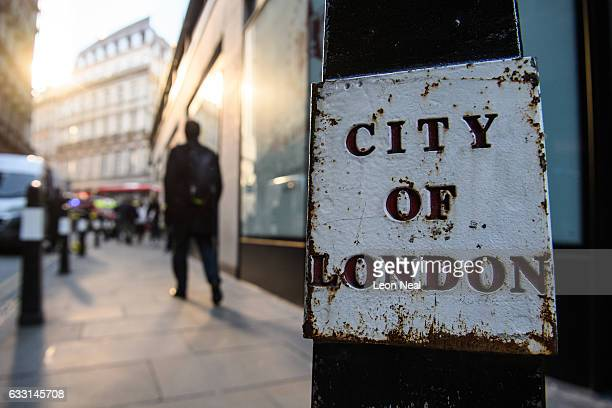 A city worker walks through the financial district also known as the Square Mile on January 20 2017 in London England Following the announcement by...