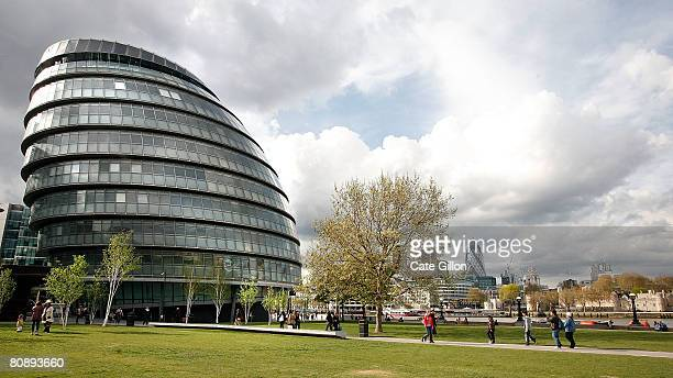City workers and tourists pass City Hall on April 28, 2008 in London, England. City Hall is the headquarters for the Mayor of London, a title due to...