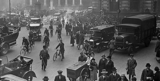City workers at Bank in London make their way to work on foot and by bicycle during the General Strike, 4th May 1926.