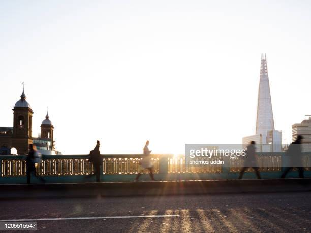 city workers at sunrise against london skyline - incidental people stock pictures, royalty-free photos & images