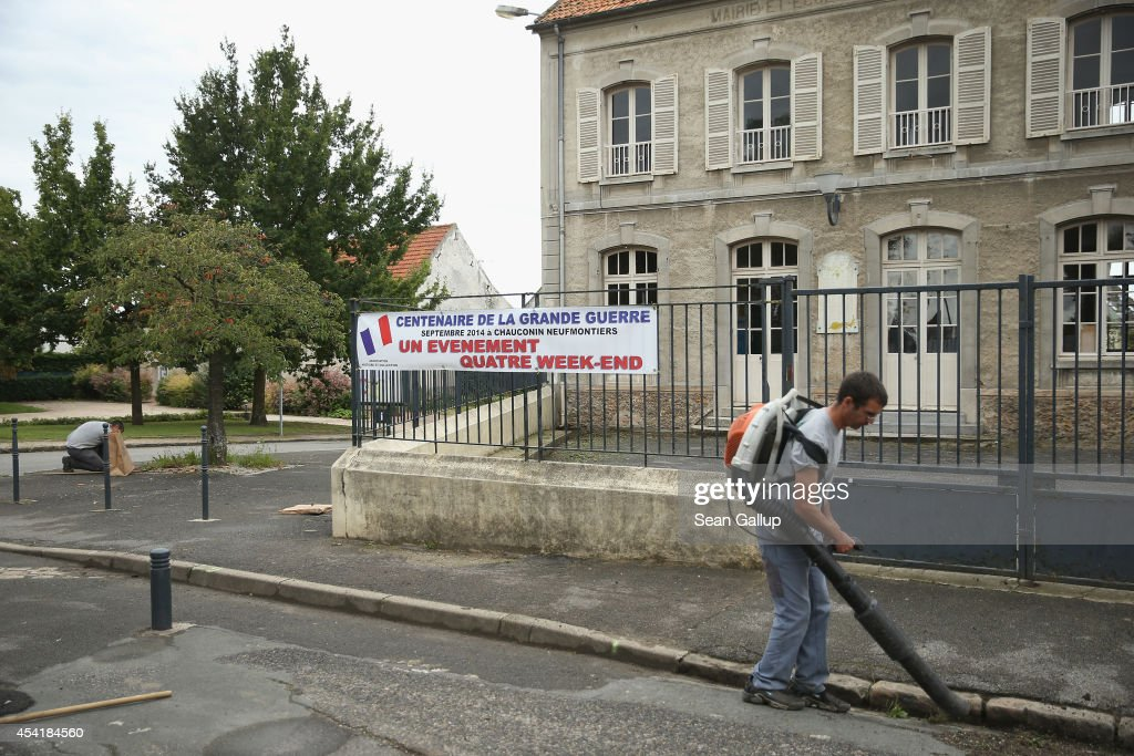 City workers clean up the main square near a sign announcing scheduled re-enactments to commemorate the 100th anniversary of the First Battle of the Marne on August 25, 2014 in Chauconin-Neufmontiers, France. At the beginning of September, 1914, German armies had nearly reached Paris when British and French arimes, after weeks of retreat, counterattacked and stemmed the German advance in the First Battle of the Marne, pushing the Germans north to what would soon become the stalemate trench war that defined the Western Front for the next four years. The Germans briefly occupied Chauconin-Neufmontiers before French and Moroccan soldiers droive them out in the early days of the battle.