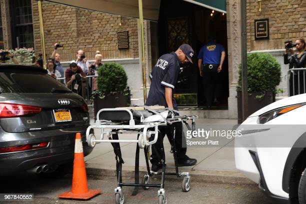 City workers enter a building to retrieve the body of fashion designer Kate Spade who was found dead in her apartment of an apparent suicide on June...