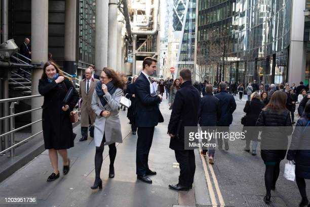 City workers greet each other at a busy lunctime in the City of London on 28th January 2020 in London, England, United Kingdom. The City of London is...
