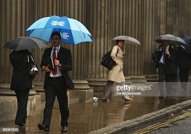 City workers make their way past the Bank Of England on September 30, 2008 in central London, England. Financial turmoil continues to hang over...
