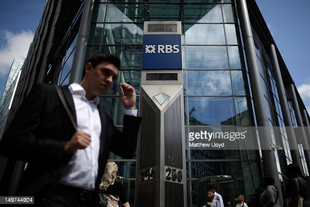 City workers pass the Royal Bank of Scotland building on Bishopsgate on August 3 2012 in London England The bank has announced pretax losses of 15...