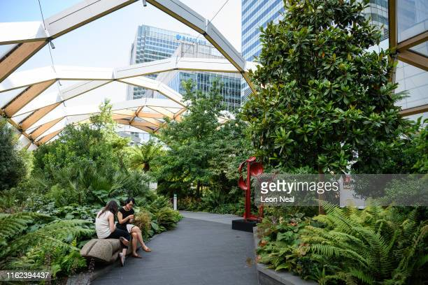 City workers relax in the Crossrail Place roof garden at Canary Wharf on July 16 2019 in London England On July 22 London will officially become the...