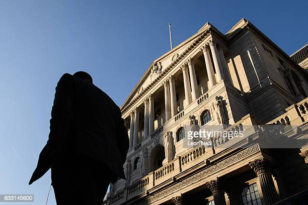 City workers walk past the Bank of England in the financial district also known as the Square Mile on January 24 2017 in London England Following the...