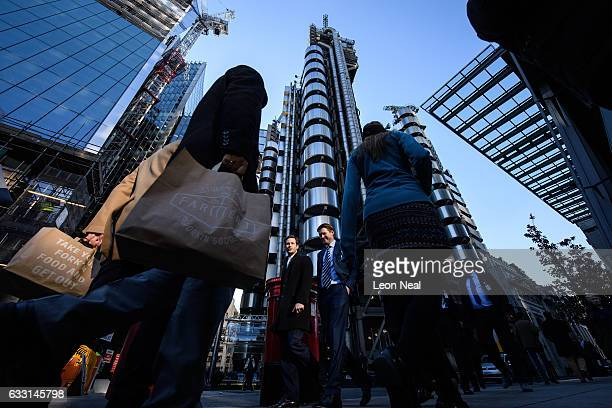 City workers walk past the Lloyds building in the financial district also known as the Square Mile on January 20 2017 in London England Following the...