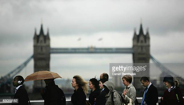 City workers walk towards the City Of London financial district on September 30 2008 in central London England Financial turmoil continues to hang...