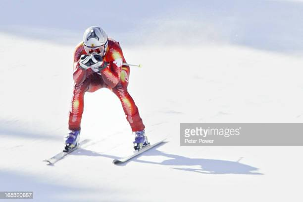 Canadian Ed Podivinsky approaches the finish line during the men's downhill on Sunday morning at the Snowbasin ski area during the 2002 Olympic...