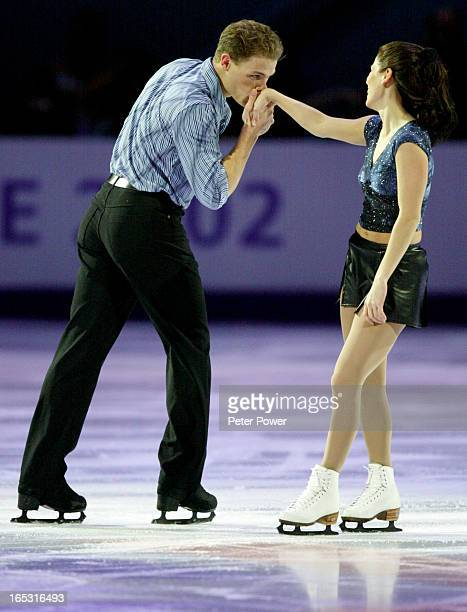 Canadians Jamie Sale and David Pelletier kissing his partners hand skating at the 2002 Winter Olympics Figure Skating Exhibition at the Salt Lake Ice...