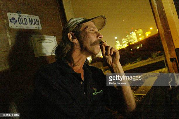 STARDIGITAL IMAGE05/30/02TENT CITYContinuing story on the tent city residents Jimmy smoking a joint in his house with his view of the city behind He...