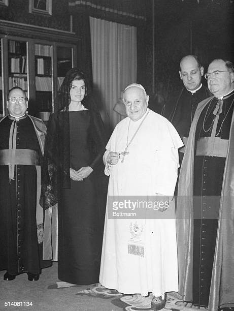 Mrs. Jacqueline Kennedy, wearing a simple black dress and black lace mantilla, stands next to Pope John XXIII during an audience here March 11th. At...