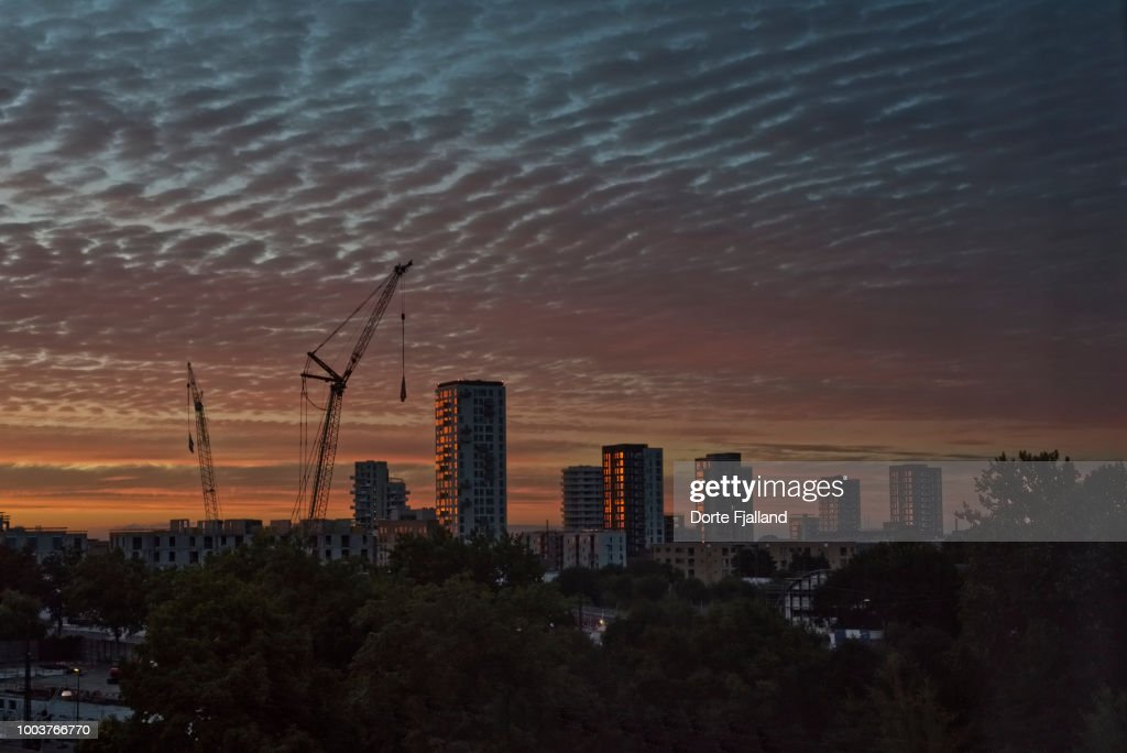 Cityscape against a clouded sky right after sunset : Foto de stock