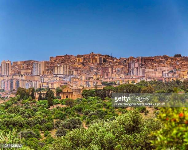 cityscape against blue sky - agrigento stock pictures, royalty-free photos & images