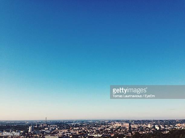 Cityscape Against Clear Blue Sky