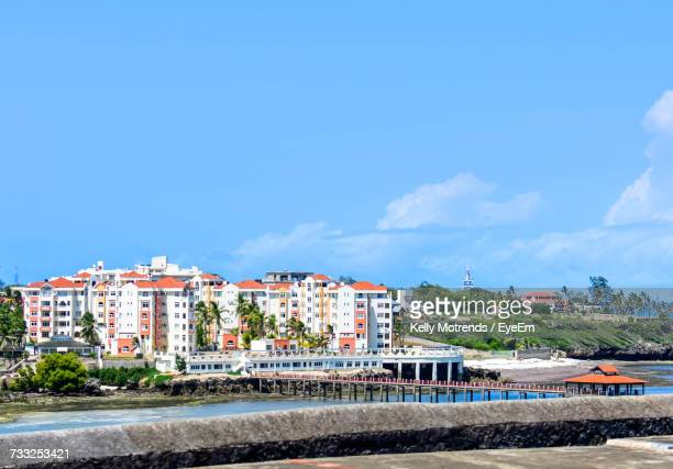 cityscape against clear blue sky - mombasa stock photos and pictures