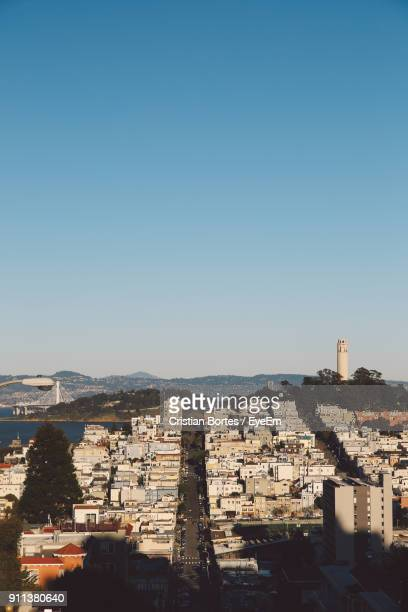cityscape against clear blue sky - bortes stock pictures, royalty-free photos & images