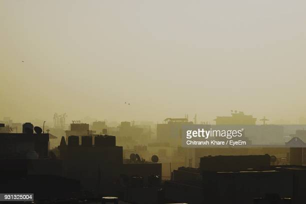 cityscape against clear sky during sunset - delhi stock pictures, royalty-free photos & images