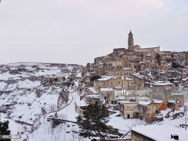 cityscape against clear sky during winter - matera stock photos and pictures