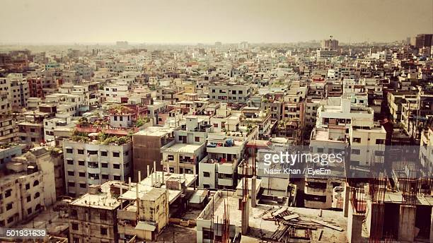 cityscape against clear sky - dhaka stock pictures, royalty-free photos & images