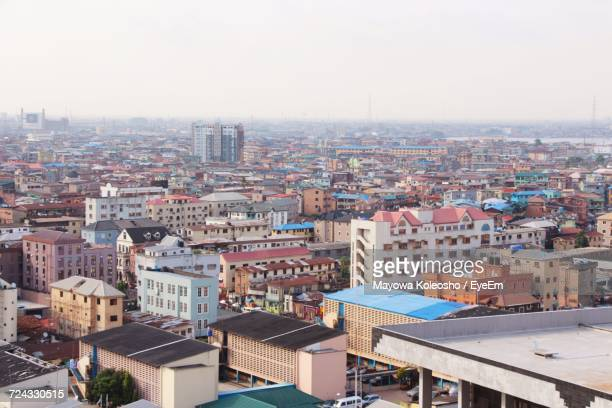 cityscape against clear sky - lagos nigeria stock pictures, royalty-free photos & images