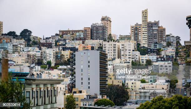 cityscape against clear sky - lombard street san francisco stock pictures, royalty-free photos & images