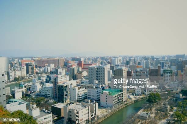 cityscape against clear sky - 福岡県 ストックフォトと画像