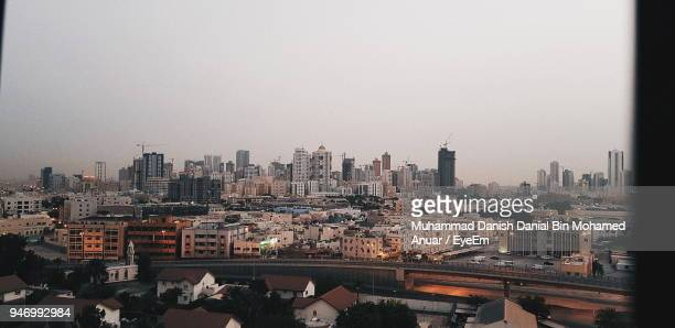 cityscape against clear sky - bahrain stock pictures, royalty-free photos & images