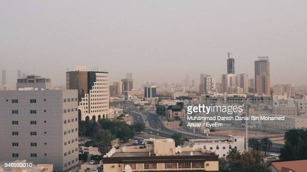 cityscape against clear sky - manama stock pictures, royalty-free photos & images