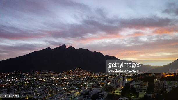 cityscape against cloudy sky at sunset - monterrey fotografías e imágenes de stock