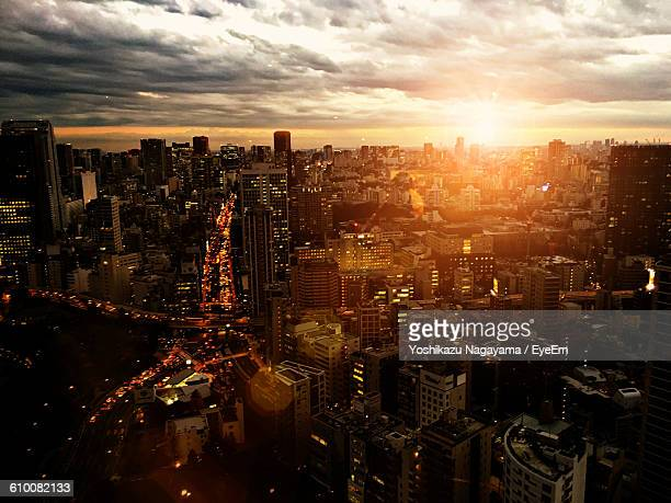 Cityscape Against Cloudy Sky During Sunrise