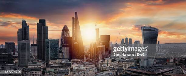 cityscape against cloudy sky during sunset - panorama stock pictures, royalty-free photos & images