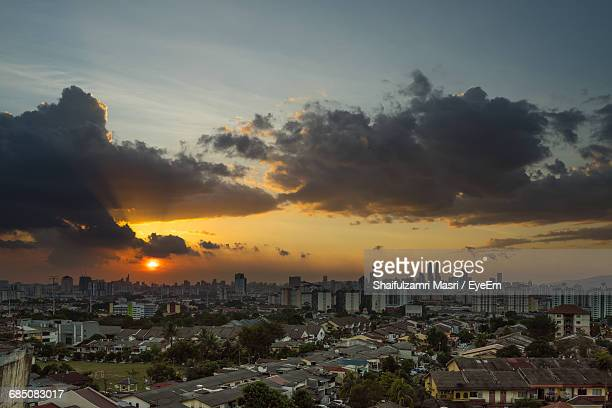 cityscape against cloudy sky during sunset - shaifulzamri eyeem stock pictures, royalty-free photos & images