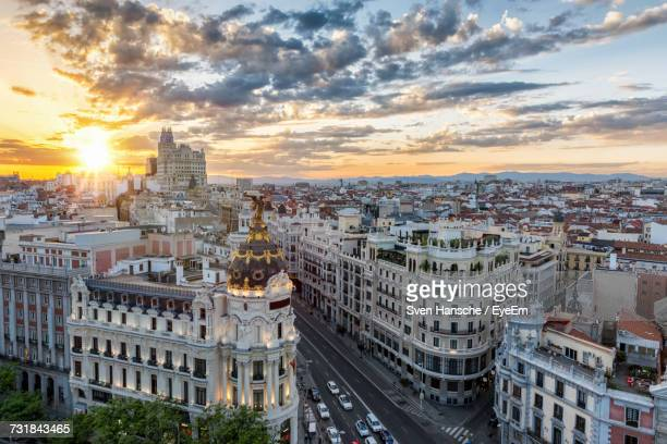 cityscape against cloudy sky during sunset - madrid stock-fotos und bilder