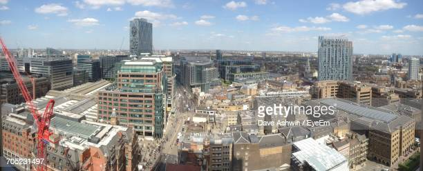 cityscape against cloudy sky - dave ashwin stock pictures, royalty-free photos & images