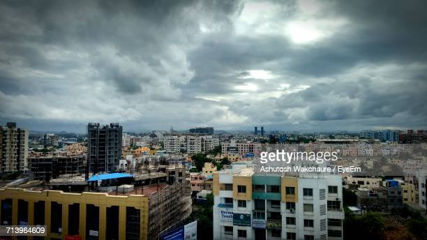 Cityscape Against Cloudy Sky