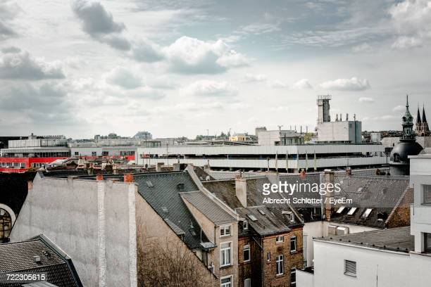cityscape against cloudy sky - albrecht schlotter stock photos and pictures