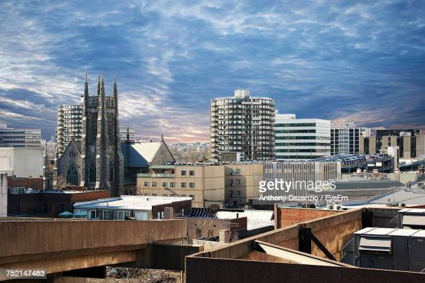 cityscape against cloudy sky - stamford connecticut stock pictures, royalty-free photos & images