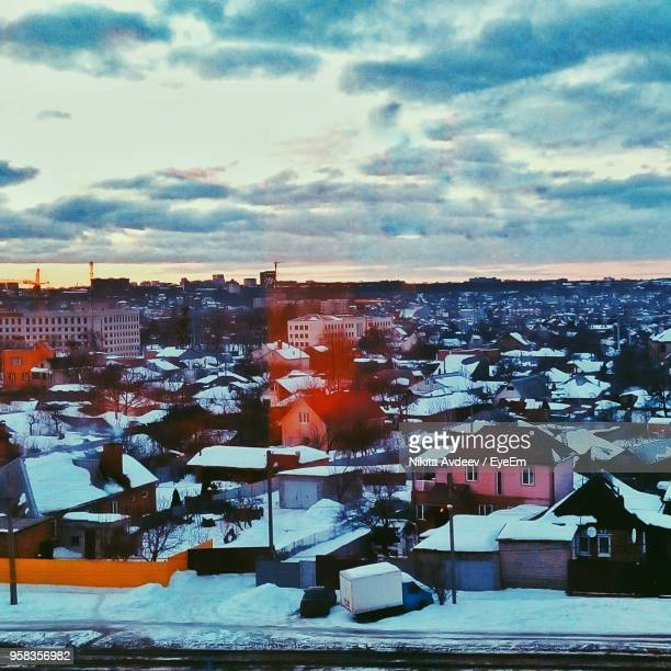 cityscape against cloudy sky - kharkov stock photos and pictures