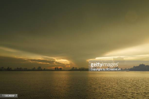 Cityscape against dramatic sky during sunset in West lake, Hanoi, Vietnam.
