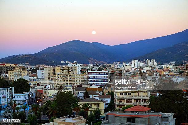 cityscape against sky at sunset - annaba algeria foto e immagini stock