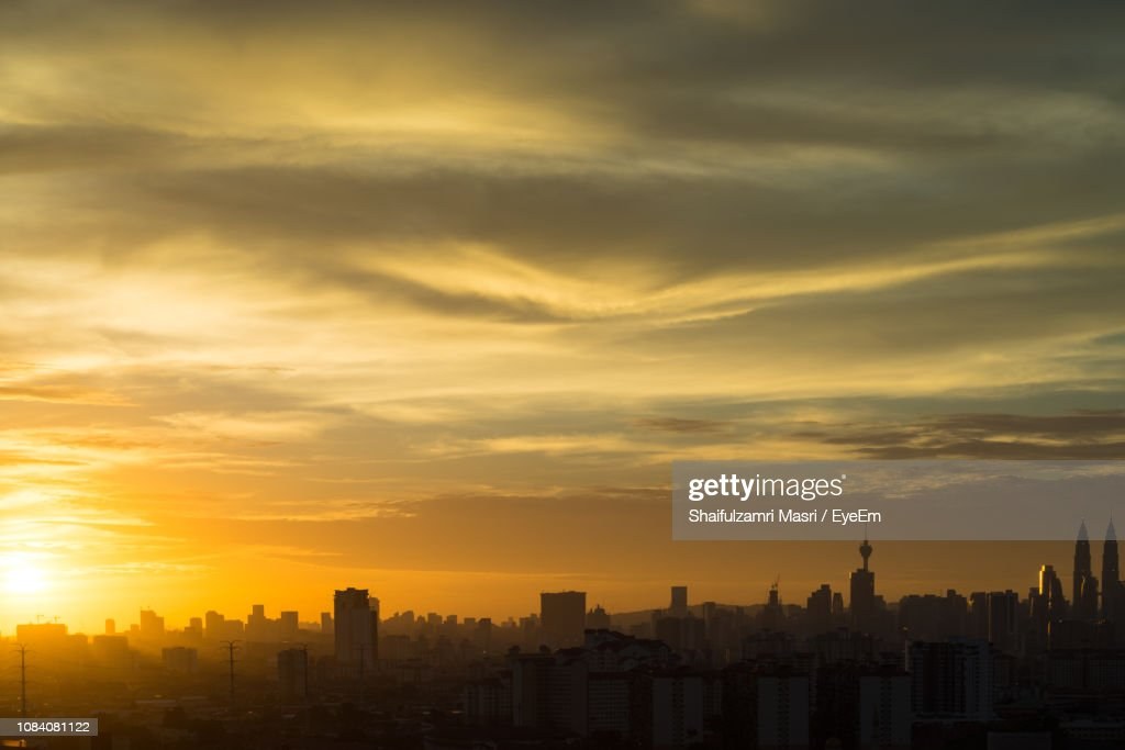 Cityscape Against Sky During Sunset : Stock Photo