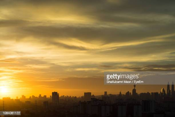 cityscape against sky during sunset - shaifulzamri stock pictures, royalty-free photos & images